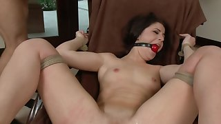 Big ass brunette gets gagged by her kinky master