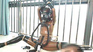 Cute Japanese latex girl, wire bondage with the addition of gas mask breathplay