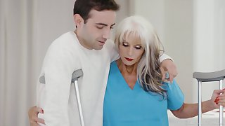 GILF physiotherapist Sally Dangelo gives a young man a sexual therapy